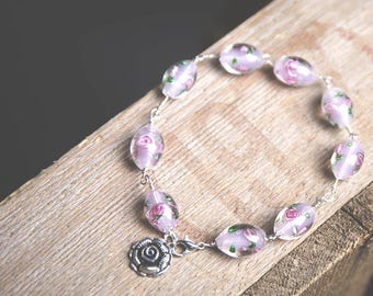 Sterling Silver bracelet with Rose Lampwork Glass Beads and Rose Charm.