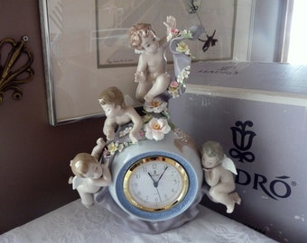 Lladro Spain #5973 Retired  and Rare ANGELIC TIME Flowers & 4 Cherubs Sculpted by Francisco Polope with its Original Box