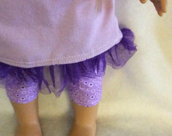 T- shirt dress with capris pants and ruffle headband with a flower.