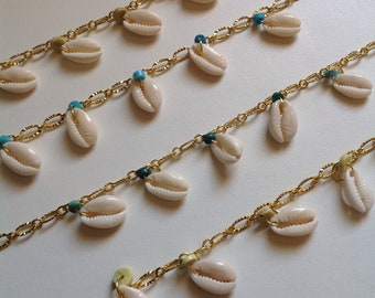String of ankle cowrie shells turquoise