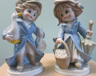Porcelain Figurines, Pair of Vintage Figurines, Girl and Boy Figurines in Blues, Cream, and Tan. Made by KPM, Sweet Heart Figurines - V103