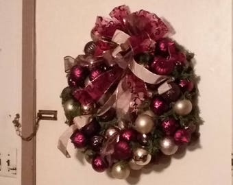 Deep red chocolate and champagne Christmas wreath