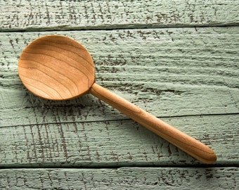 Wooden serving and cooking spoon handmade in Vermont cherry with shallow round bowl beautiful grain sanded super smooth