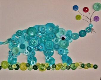 Elephant holding balloons