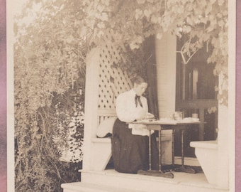 Antique photo, woman eating in garden, early 1900s, historical, snapshot, outdoors, food, womens studies, womens history, feminism, fashion