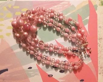 Vintage pink plastic bead necklace