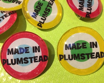Made In Plumstead glass badge brooch or magnet