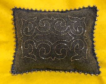 Decorative pillow with ethnic bead embellishments