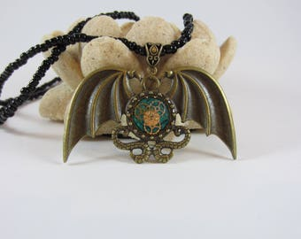 Steampunk Resin Pendant on Bronze Batwing Bezel with a beaded necklace