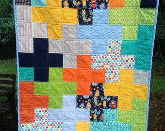 Baby Boy Quilt with Silly Little Monsters and Modern Plus Sign Design, made with all bright colors