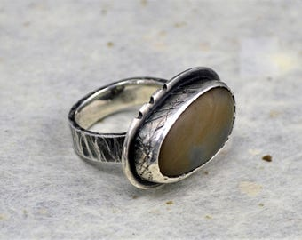 Beach pebble ring with square hammered band.