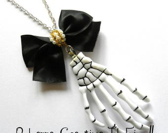 Necklace - Hand dark goth skeleton black and gold bow