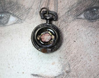Unisex Steampunk  Pendant, bronze colour pocketwatchcase, cogs, coral flower,    in clear resin, On a black leather strap
