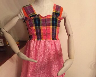 creole dress for little girl with a fabric multicolored madras with opening pink eyelet skirt