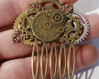 vintage steampunk gears and clock and leaf comb