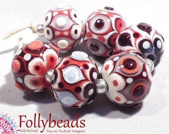 Handmade Lampwork Artisan glass bead set of raked dots in Coral, Dark Brown, Ivory and Transparent Blue.