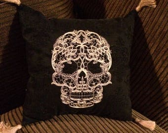 Embroidered gold lace skull accent pillow. 10x10