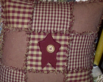 burgundy primitive rag pillow with star and wooden button
