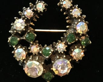 Horseshoe Pin or Brooch with Rhinestones and Emerald Colored Glass Stones