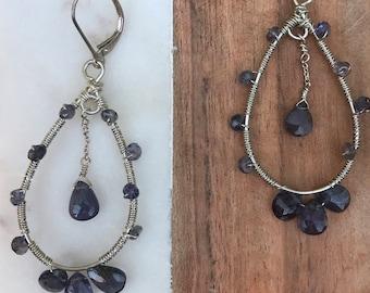 Sterling silver elongated hoop earrings wrapped with iolite gemstones