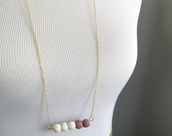 Lava stone white and dusty pink diffuser necklace