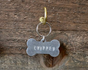 Chipped Dog Tag