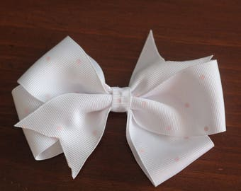 White and pink dot bow clip