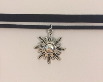 Velvet and  faux suede black ribbon choker necklace with sun charm
