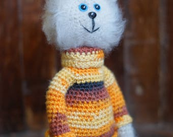 A cat, a fluffy cat, a cat in a sweater, a toy cat, a knitted cat, a knitted toy