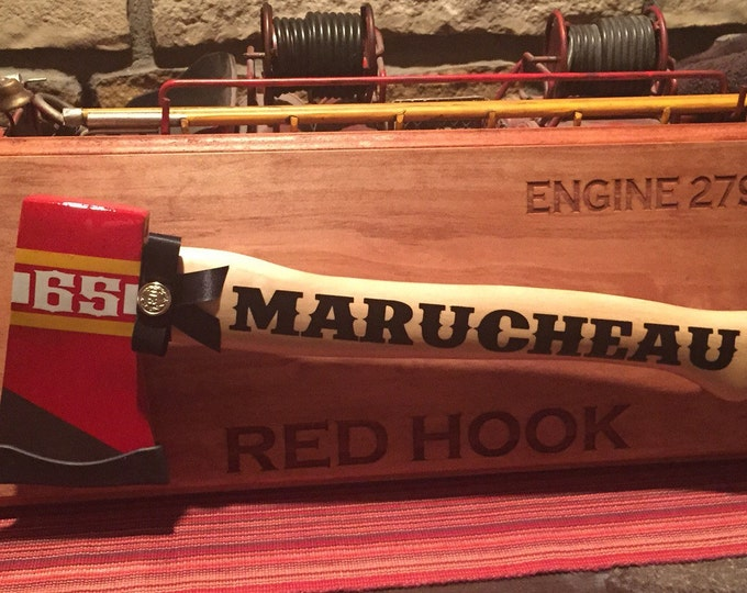 Personalized firefighter graduation or retirement axe.