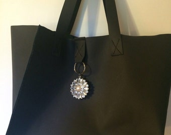 Black leather tote bag with open top, leather handbag