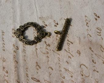 set of 4 metal clasps bronze