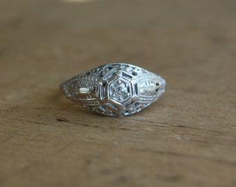 Antique 18K filigree bombe diamond enagement ring