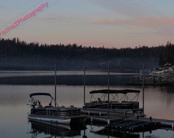 Sunrise over the foggy lake