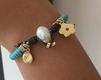 Macrame  bracelet with fresh water pearl and and  goldfield charms.