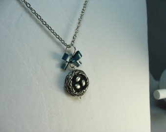Bird nest necklace ... antique silver birds nest with eggs and deep blue metal bow charm on silver chain ... life is a gift