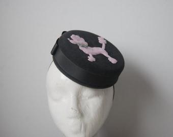 Grey & pink Poodle pillbox hat.