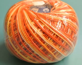 Vintage 1980s 40 grams flamy swirled orange/ red cotton yarn ball for chrocheting or embroidery