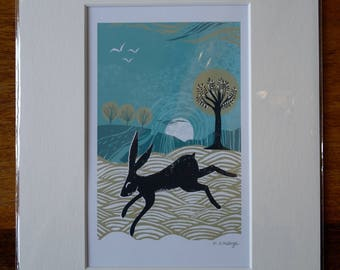 Mounted 'winter hare' print