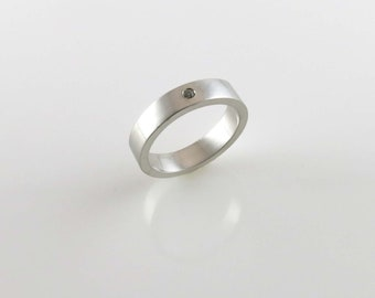 Sterling silver ring with clear sapphire