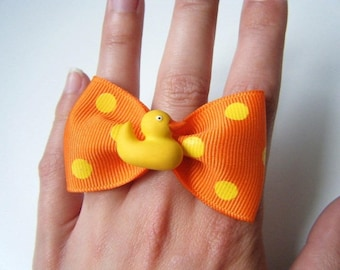 Duck and polka dot bow tie ring
