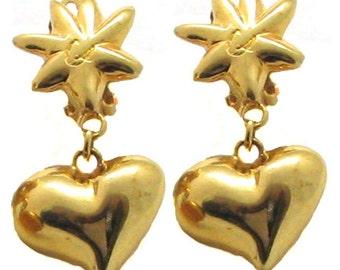 Boucles d'oreilles CHRISTIAN LACROIX, pendantes dorées.