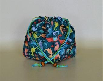 Dinosaur dice bag 9x9x12cm