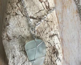 Aqua sea glass necklace, hand wrapped onto a silver chain.