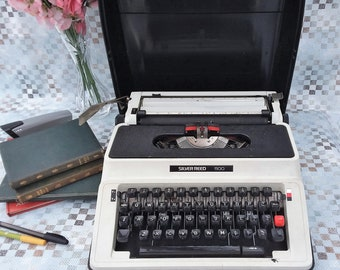 Typewriter, Silver Reed 500, Grey and black, portable manual typewriter, working order.