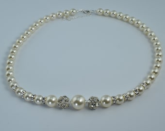 Swarovski pearl and crystal necklace.Lustrous cream pearls and sparkling crystal rondelles with Preciosa crystal balls.Sterling silver clasp
