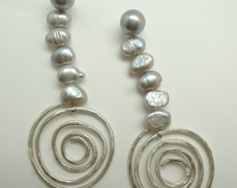 Uniquely designed, multiple style silver earrings with pearl