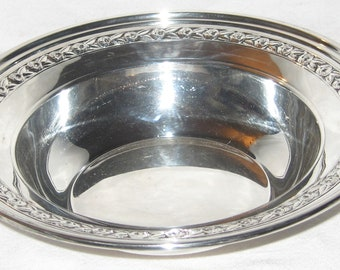 Vintage Reed & Barton #1204 silverplate round serving bowl with roses pattern around the edge