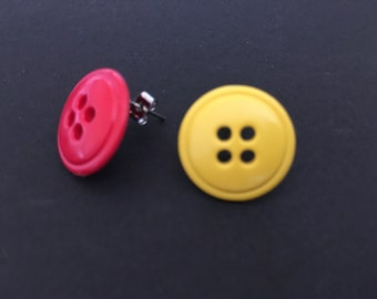 Mismatch round button stud earrings in yellow and red.