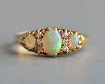 Antique Victorian Era jelly opal and diamond band ring in 18k gold